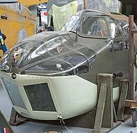 Name: Nose Glazing.jpg Views: 21 Size: 67.0 KB Description: A fully restored example.  The navigator could just sit in the right side of the nose and get his arms over the nav table under the scooped-out left side.