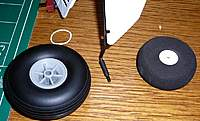 Name: Skrt-old-wheels.jpg Views: 394 Size: 104.2 KB Description: old wheel right new on left. Shrink tube on axle to make up for extra size of wheel, rubber band removed preparing to tie on skirt