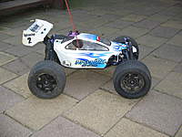 Name: 005.jpg Views: 995 Size: 96.9 KB Description: Modified Kyosho Inferno 1/8 Buggy Now Runs Hpi Savage Drive train (Wheels, Tyres, Axles, Dogbones, Upper & Lower Arms, Diffs, Shocks, .28 (4.6cc) Engine.