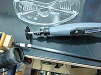 Name: DSC00459.jpg Views: 120 Size: 72.6 KB Description: How to cut carbon fiber rod or tube. Masking tape, Dremel, vaccun cleaner and glasses.