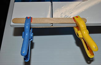I use spring clamps and popsicle sticks to hold the surfaces neutral while adjusting push rod lengths.