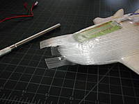 Name: PA050117.jpg Views: 99 Size: 60.1 KB Description: where the tape wants to wrinkle follow the fiberglass threads and tear tape and lay down each piece in some sort of order or simply cut it off wear there is already tape