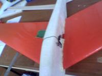 Name: Image003.jpg Views: 256 Size: 28.3 KB Description: the pu glue after it had set made a nice chance for a wing fillet so with sanding paper in hand , it made a nice join line.