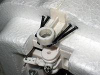 """Name: IMG_1748ed.jpg Views: 63 Size: 238.8 KB Description: reinforced nosegear guide. Rods are about 3"""". go back on widening angle in middle of foam width. really stiffened it up. Highly recommend removing control arm and using thin CA to glue the metal inner piece to the plastic arm."""