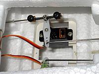Name: IMG_1765ed.jpg Views: 69 Size: 239.7 KB Description: servo saver for nosewheel. had to use longer lockeing screws.