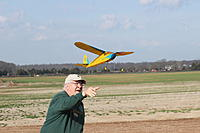 Name: IMG_2575_2.jpg Views: 74 Size: 408.2 KB Description: Me launching my ancient Pacific Ace--built her back in 1989 and still flying -- I have done some repair to the tissue and haven't repainted yet--but she sure does fly.  Note the field--lots of room.