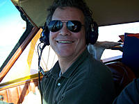 Name: Chris and Tiporare.jpg Views: 179 Size: 154.4 KB Description: Flying the Tiporare home from AZ in the Staggerwing.