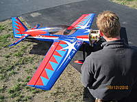 Name: Nate with Chucks plane.jpg Views: 75 Size: 138.5 KB Description: Nate with Cryhavoc's Mx2, now gas powered