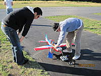 """Name: Flops new EF 48.jpg Views: 49 Size: 115.2 KB Description: Flopgun's new 48"""" Extreme Flight and Mike looking on."""