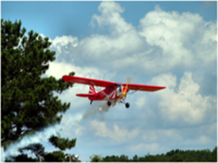 Name: Glow-fuel-plane-flying-over-hinkle-field.png