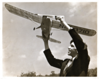 Name: Oscar-with-Free-Flight-Model-Plane.png