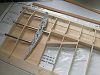 Name: Picture or Video 053.jpg Views: 189 Size: 79.4 KB Description: Fettling the root ribs and tubes, also started to add the rear drag spar.