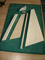 Name: Picture or Video 067.jpg Views: 134 Size: 66.3 KB Description: Fin and rudder parts, the sheet is made from two parts, the upper portion grain runs lengthwise (anti-twist?).
