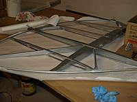 Name: Picture 050.jpg Views: 71 Size: 57.0 KB Description: Cutting fabric to size for the rudder.
