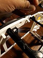 Name: 20190501_233731.jpg Views: 6 Size: 386.4 KB Description: check that the rabbet of the tab insert correctly . Use auxiliar 0.8mm piano wire check . In this photo I check it before glue the cage, but doesn´t matter.