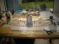 Name: DSCN9398.jpg Views: 341 Size: 247.0 KB Description: Glueing the wing segments together with dihedral. I tried to make it about 6 degrees which is the original full size value.