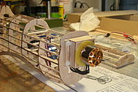 Name: DSCN9749.jpg Views: 369 Size: 192.1 KB Description: Motor mount made of 0.4mm ply. Motor is bolted onto the mount from inside. Motor mount is bolted to the firewall with nylon bolts and nuts.