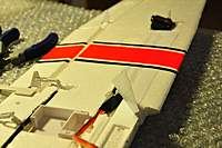 Name: Cessna182_25.jpg Views: 444 Size: 54.2 KB Description: The servo lead and the extension under the adhesive tape.