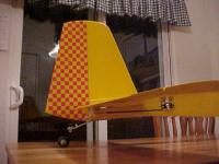 Name: MVC-025F.jpg Views: 454 Size: 68.7 KB Description: Fuzzy low-light pic of tail group.  I had to add a ventral fin (hardwood) to mount the tailwheel.  The tail is plenty stiff and strong.