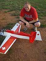 Name: IMGP1086.jpg Views: 138 Size: 109.9 KB Description: This is me with my Greatplanes 40 size CAP 232.  There is no cowl or canopy.  This is my first plane that I bought wrecked.