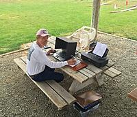 Name: Chris B at the scoring laptop.jpeg Views: 72 Size: 216.4 KB Description: Chris B. setting up the rounds.
