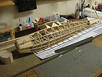 Name: 002.jpg Views: 51 Size: 224.7 KB Description: Can't wait to see how well I can blend the nose block into the nose contours. Weight of the fuselage and nose block is 3.8oz.