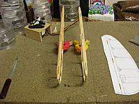 Name: 003.jpg Views: 37 Size: 256.7 KB Description: The one on the left is the reject. The top hinge is not in line with the others. I really like the laminated one on the right and wish I had done the trailing edge of the vertical stabilized the same way.