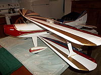 Name: 100_5683 2.jpg Views: 14 Size: 159.7 KB Description: I think u can see the narrow slots in the lower wing where the strut wire slides into the wing. You push down, and then slide forward to lock them in place.