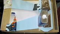 """Name: BirdofPreyWing1.jpg Views: 68 Size: 108.4 KB Description: At this point I am attaching the wings to the fuselage using the Elmer's glue you see in the picture.  What you cannot see is the foam piece under the fuselage to lift it 1/2""""."""