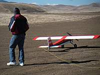 Name: Pegasoarus on a leash.jpg Views: 234 Size: 116.1 KB Description: It needs a leash on windy days due to the slope of the runway. Peter said he needs brakes!