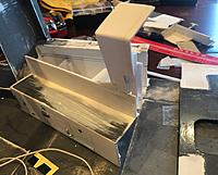 Name: C5124E4E-E8AA-485B-A813-1EB106148BDE.jpeg Views: 4 Size: 1.76 MB Description: The whole bench seat with attached vent housing comes out as a single unit. The added supporting brackets/components  underneath  make for a no-glue reinstall. I can pull the entire unit out to work on it and it reinstalls snugly against the floor. Neat!
