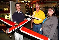 Name: AMA Museum Muncie September 2009.jpg Views: 138 Size: 93.9 KB Description: The Taurus as used by Ed is in the Museum of AMA Muncie, Maria VanVreede (r), Michael Smith (L), both of AMA and Bob Noll of VR/CS in center