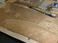 Name: tm88b.jpg Views: 72 Size: 183.1 KB Description: The forecastle rails were made from basswood strips, wood glue and cut nails.  I clamped them along the bow to get the right curve.