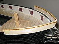 Name: tm93b.jpg Views: 93 Size: 156.6 KB Description: After two weeks of planning, shaping and glue/epoxy drying we finally have a forecastle rail.