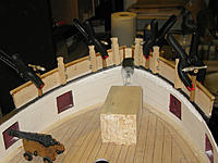 Name: tm105b.jpg Views: 68 Size: 159.0 KB Description: Swivel gun clamp day.  Pinned and epoxied to the forecastle's fiberglass lip and wood-glued to the rail.