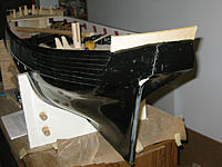 Name: tm112b.jpg Views: 52 Size: 137.0 KB Description: The transom piece was pinned in place with a slight overlap, and then sanded to fit.