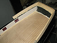 Name: tm113b.jpg Views: 57 Size: 165.4 KB Description: Sanding the sides of the poop deck and leveling the tops.