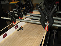 Name: tm114b.jpg Views: 55 Size: 172.2 KB Description: Adding the top planks to form the outline of the poop deck.  The transom part required some shaping.