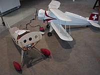 """Name: 2011 Model Airplanes 003.jpg Views: 182 Size: 43.0 KB Description: The Pitts fuselage in relation to the 42"""" Bucker Youngmeister, the current star performer of the fleet."""