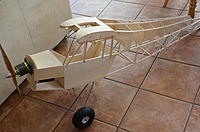 """Name: DSC_5002.jpg Views: 938 Size: 189.2 KB Description: The motor and prop weigh almost as much as all of the balsa and hardwood behind it - 1.95lbs or .88kg  Dubro 5.5"""" tires"""