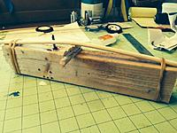 Name: OSK55.jpg Views: 137 Size: 142.9 KB Description: Warping the dowels to match the wing dihedral.  I attached them to a 2x4, and applied steam, while inserting wedges until the angle was right.