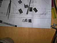 Name: landing gear 029.jpg Views: 82 Size: 128.4 KB Description: starting to grind the shape and comparing it to a rough piece.