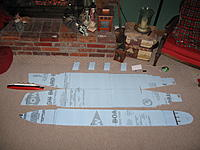 Name: flat.jpg Views: 419 Size: 239.6 KB Description: Here are the unfolded foam cutouts of the ships hull, as well as the upper decks. I used a small model of the titanic for reference.