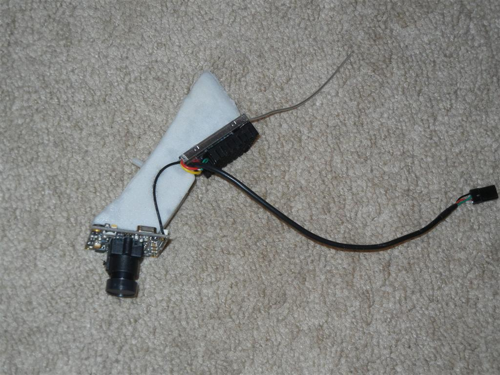 Name: FPV pod.jpg Views: 202 Size: 146.2 KB Description: This pod is what I put together so not to tie up my Fun Cub. There is a pylon mount on the wing where the one bolt holds it in place. The pod only needs 12V DC and has the 1.3GHz TX just behind the camera. I put a heat sink on it just because the other si