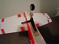 """Name: IMG_1194.jpg Views: 551 Size: 286.6 KB Description: R2Hobbies steerable tail wheel. I've mounted an extra servo on on the belly of the plane (with a """"Y"""" servo cable on the rudder channel). Ground steering works, but I feel it's too sensitive at high speeds."""