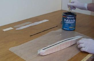 Minwax Polycrylic is used as a simple non-messy way to reinforce a balsa fuselage with fiberglass and carbon fiber