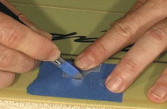 Paul recommends cutting the aileron servo holes with a knife and a template.