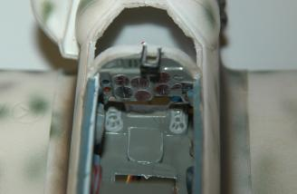 Here is a view of the cockpit minus the pilot.  The battery installs in the opening forward of the dash board.  The wing can be relieved to allow longer than normal batteries to be used.  The wing was relieved during assembly to allow the PolyQuest 800mAh