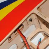 Detail of wing installation showing socket-head cap screw locking wing in place and servo wires entering fuselage. An antirotation dowel is also in the wing's trailing edge.
