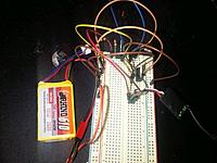 Name: RF module off.jpg Views: 272 Size: 58.0 KB Description: The 3.3V regulator (right) provides a simulated digital HIGH voltage to the + rail on the right side of the board, which leads to the base pin on the transistor.  This signal causes the transistor to short the ADJ pin of the LM317 to ground and thus shut